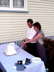 Frank and Mags cutting their homemade wedding cake