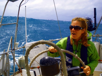Tiffany helming through the big swell on the way up to Whangaruru