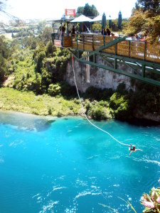 Bungee Jumper recoiling up after dipping into the river outside Taupo