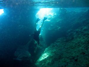Snorkeling through an underwater cave near Port Maurelle